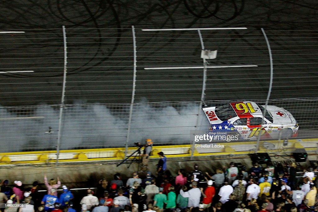 Greg Biffle blows the engine of the #16 3M/American Red Cross Ford, during the NASCAR Sprint All-Star Race at Charlotte Motor Speedway on May 19, 2012 in Charlotte, North Carolina.