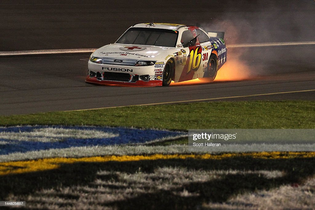 Greg Biffle blows the engine of the #16 3M/American Red Cross Ford during the NASCAR Sprint All-Star Race at Charlotte Motor Speedway on May 19, 2012 in Charlotte, North Carolina.