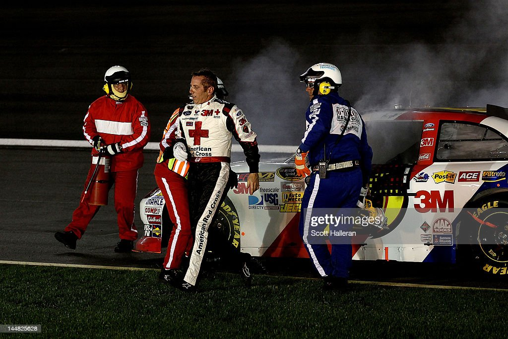 Greg Biffle climbs out of the #16 3M/American Red Cross Ford after blowing an engine during the NASCAR Sprint All-Star Race at Charlotte Motor Speedway on May 19, 2012 in Charlotte, North Carolina.