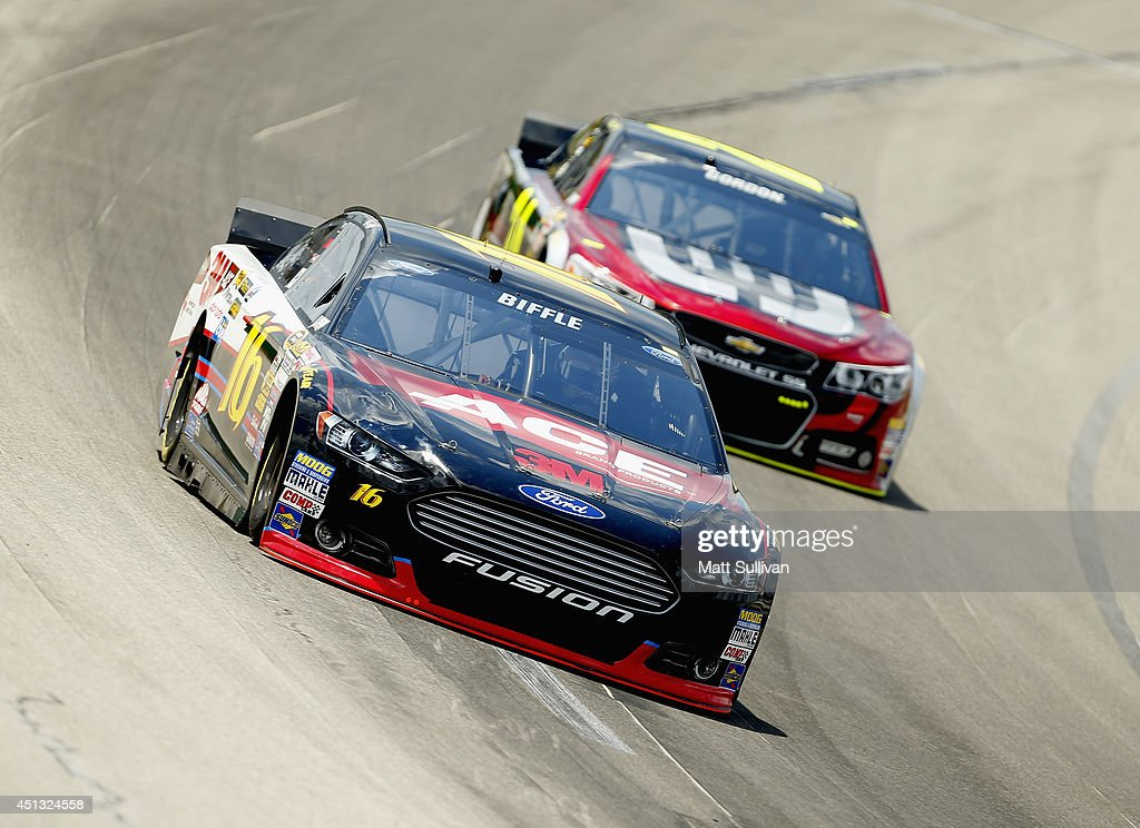 Greg Biffle, driver of the #16 3M ACE Bandage Ford, leads Jeff Gordon, driver of the #24 Drive to End Hunger Chevrolet, during practice for the NASCAR Sprint Cup Series Quaker State 400 presented by Advance Auto Parts at Kentucky Speedway on June 27, 2014 in Sparta, Kentucky.