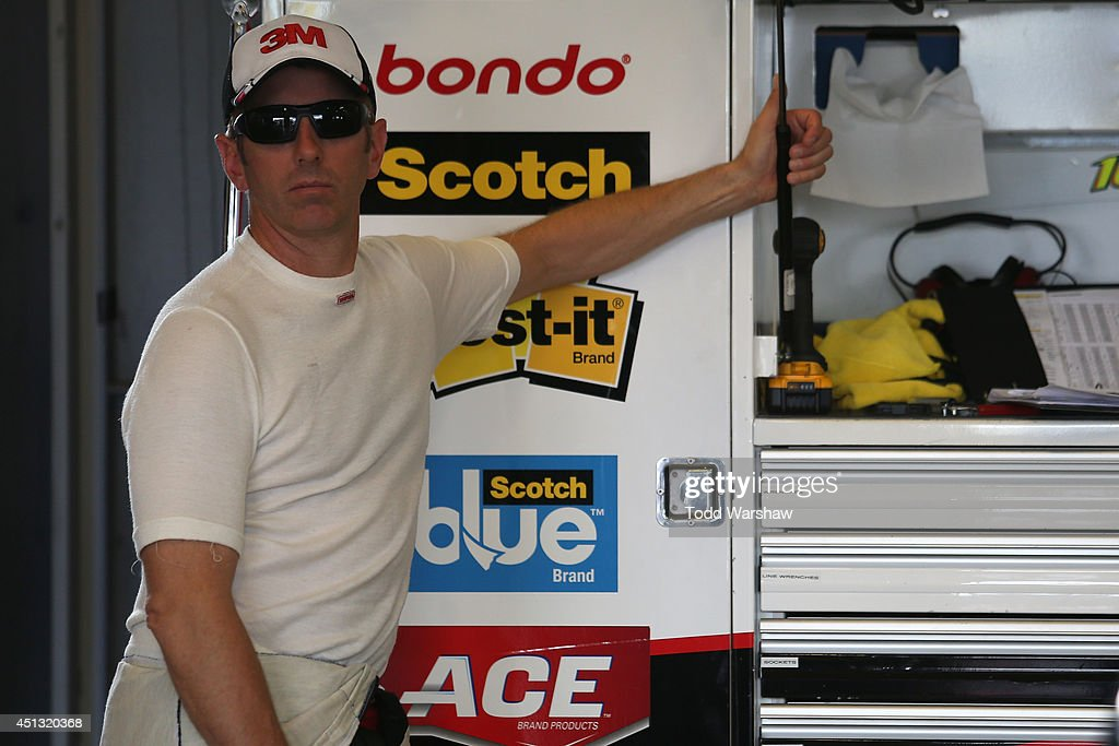 Greg Biffle, driver of the #16 3M ACE Bandage Ford, looks on in the garage area during practice for the NASCAR Sprint Cup Series Quaker State 400 presented by Advance Auto Parts at Kentucky Speedway on June 27, 2014 in Sparta, Kentucky.