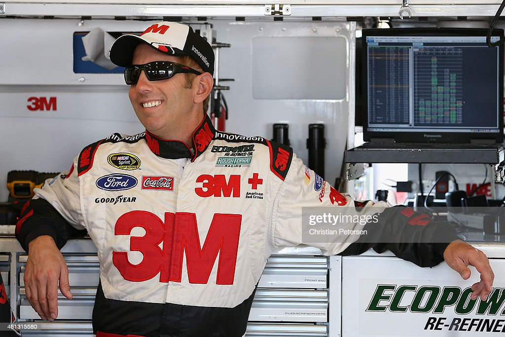 Greg Biffle, driver of the #16 3M ACE Bandage Ford, stands in the garage area during practice for the NASCAR Sprint Cup Series Quaker State 400 presented by Advance Auto Parts at Kentucky Speedway on June 27, 2014 in Sparta, Kentucky.