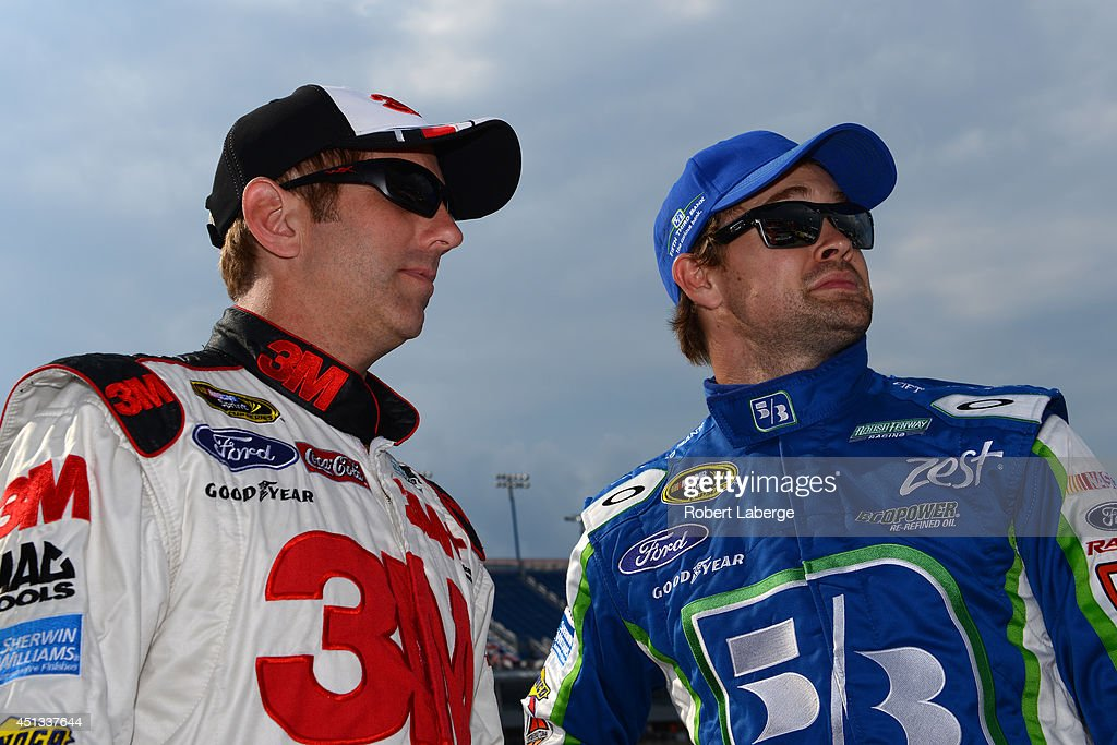 Greg Biffle, driver of the #16 3M ACE Bandage Ford, talks with Ricky Stenhouse Jr., driver of the #17 Fifth Third Bank Ford, during qualifying for the NASCAR Sprint Cup Series Quaker State 400 presented by Advance Auto Parts at Kentucky Speedway on June 27, 2014 in Sparta, Kentucky.