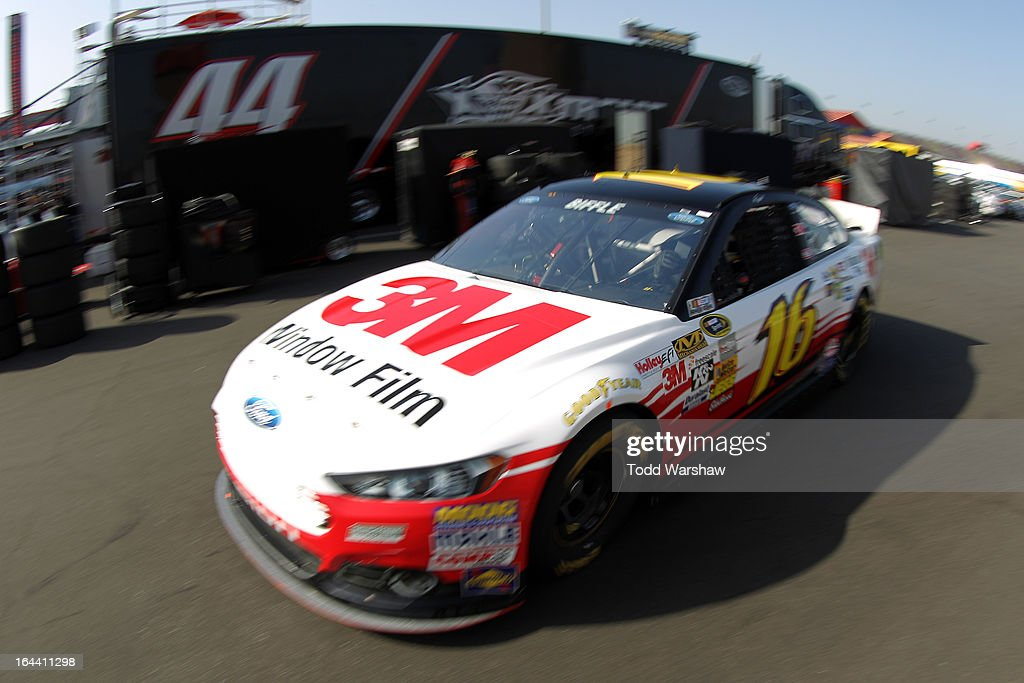 Greg Biffle, driver of the #16 3M Ford, drives to the garage area during practice for the NASCAR Sprint Cup Series Auto Club 400 at Auto Club Speedway on March 23, 2013 in Fontana, California.