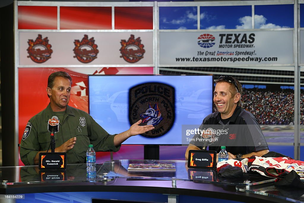 Greg Biffle, driver of the #16 3M Ford Fusion, participates in a narcotic detection exercise with Fort Worth Police Department officer Harald Cussnick involving Kelev, a Fort Worth Police Department K-9, during an exhibition at Texas Motor Speedway on March 20, 2013 in Fort Worth, Texas.