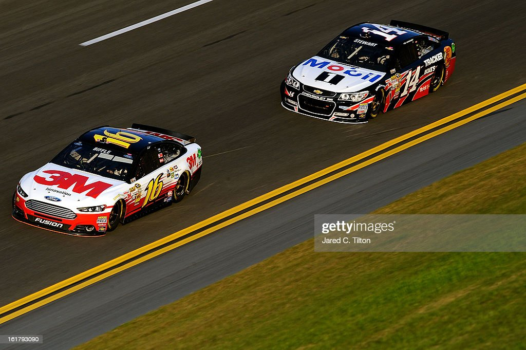 Greg Biffle, driver of the #16 3M FordMobil 1/Burger King, and Tony Stewart, driver of the #14 Bass Pro Shops/Mobil 1 Chevrolet, during practice for the NASCAR Sprint Cup Series Daytona 500 at Daytona International Speedway on February 16, 2013 in Daytona Beach, Florida