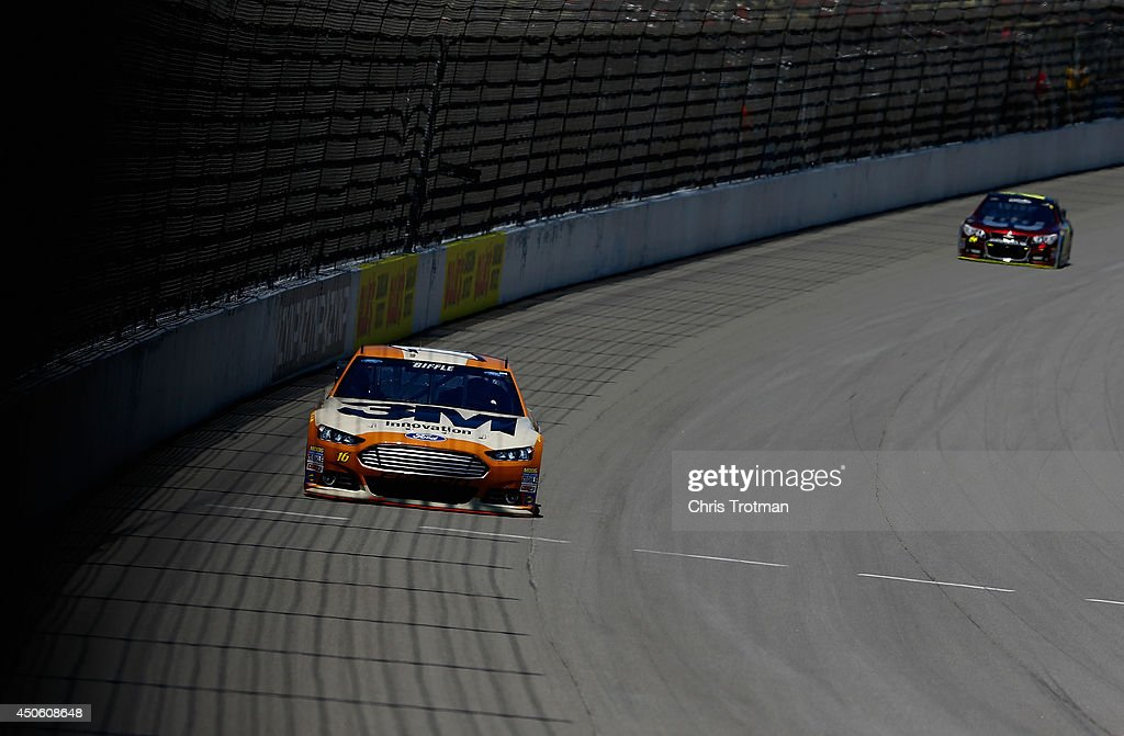 Greg Biffle, driver of the #16 3M Military Salute Ford, leads Jeff Gordon, driver of the #24 Drive to End Hunger Chevrolet, during practice for the NASCAR Sprint Cup Series Quicken Loans 400 at Michigan International Speedway on June 14, 2014 in Brooklyn, Michigan.