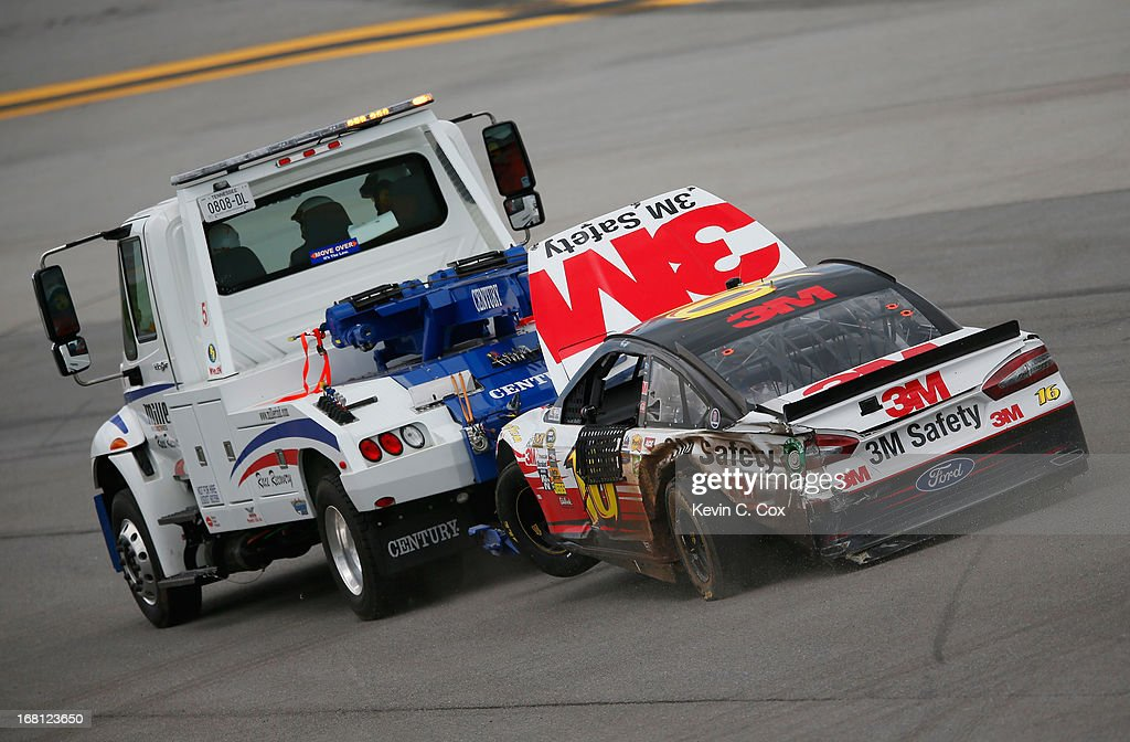 Greg Biffle, driver of the #16 3M Safety Ford, is towed down the backstretch after a wreck in between turn one and two during the NASCAR Sprint Cup Series Aaron's 499 at Talladega Superspeedway on May 5, 2013 in Talladega, Alabama.