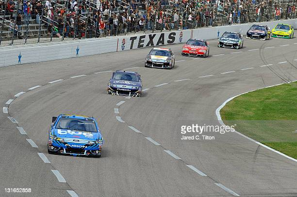 Greg Biffle driver of the 3M ScotchBlue Painter's Tape Ford leads Matt Kenseth driver of the Crown Royal Ford during the NASCAR Sprint Cup Series AAA...