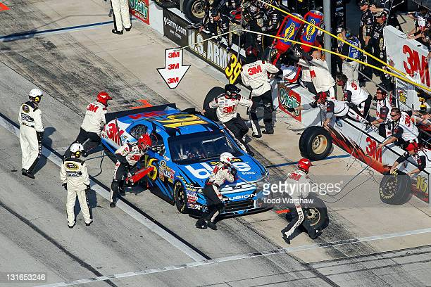 Greg Biffle driver of the 3M ScotchBlue Painter's Tape Ford pits during the NASCAR Sprint Cup Series AAA Texas 500 at Texas Motor Speedway on...
