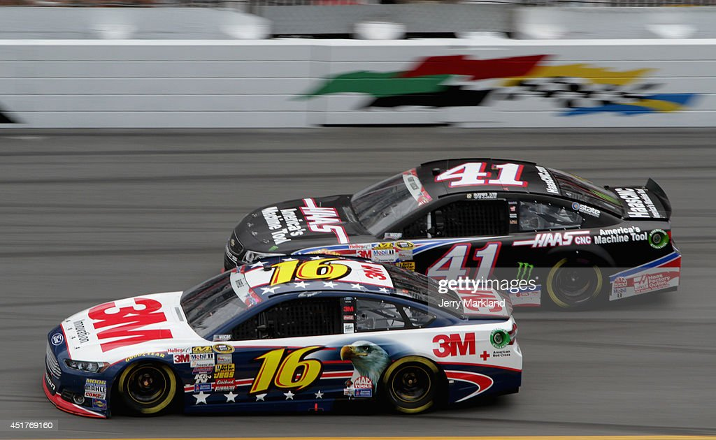 Greg Biffle, driver of the #16 3M Stars & Stripes Ford, leads Kurt Busch, driver of the #41 Haas Automation Chevrolet, during the NASCAR Sprint Cup Series Coke Zero 400 at Daytona International Speedway on July 6, 2014 in Daytona Beach, Florida.