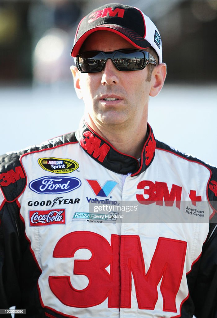 <a gi-track='captionPersonalityLinkClicked' href=/galleries/search?phrase=Greg+Biffle&family=editorial&specificpeople=209093 ng-click='$event.stopPropagation()'>Greg Biffle</a>, driver of the #16 3M/GE Appliances Ford, stands on pit road during qualifying for the NASCAR Sprint Cup Series Sylvania 300 at New Hampshire Motor Speedway on September 21, 2012 in Loudon, New Hampshire.