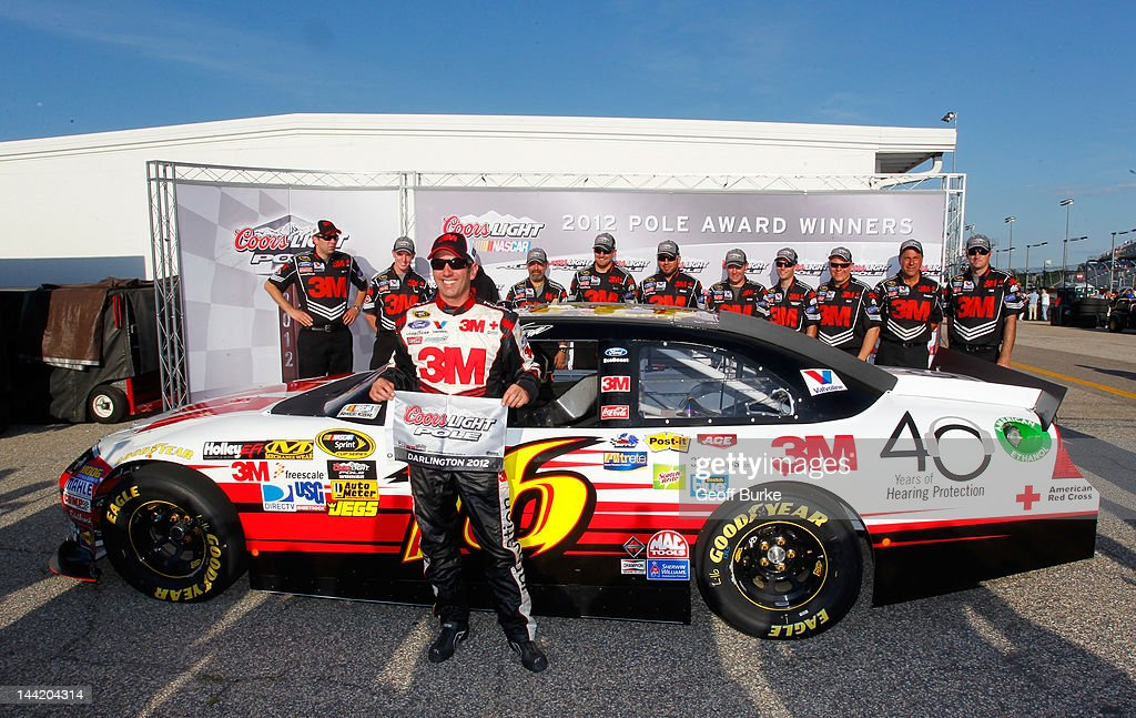 <a gi-track='captionPersonalityLinkClicked' href=/galleries/search?phrase=Greg+Biffle&family=editorial&specificpeople=209093 ng-click='$event.stopPropagation()'>Greg Biffle</a>, driver of the #16 3M/OH/ES Ford, poses with the Coors Light Pole Award after qualifying for pole position for the NASCAR Sprint Cup Series Bojangles' Southern 500 at Darlington Raceway on May 11, 2012 in Darlington, South Carolina.
