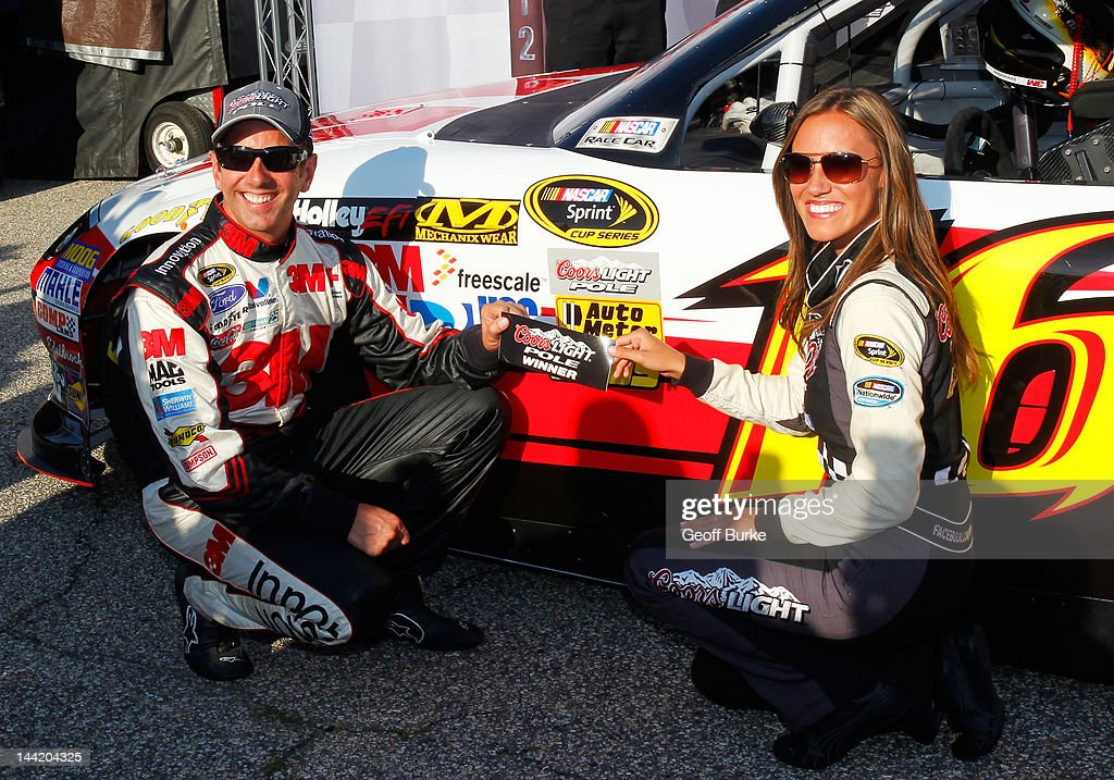 <a gi-track='captionPersonalityLinkClicked' href=/galleries/search?phrase=Greg+Biffle&family=editorial&specificpeople=209093 ng-click='$event.stopPropagation()'>Greg Biffle</a>, driver of the #16 3M/OH/ES Ford, poses with the Coors Light Pole Award decal and Miss Coors Light Rachel Rupert after qualifying for pole position for the NASCAR Sprint Cup Series Bojangles' Southern 500 at Darlington Raceway on May 11, 2012 in Darlington, South Carolina.
