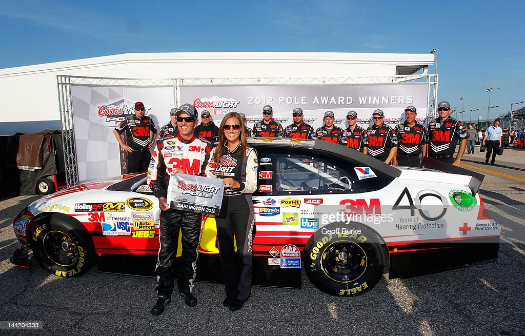 <a gi-track='captionPersonalityLinkClicked' href=/galleries/search?phrase=Greg+Biffle&family=editorial&specificpeople=209093 ng-click='$event.stopPropagation()'>Greg Biffle</a>, driver of the #16 3M/OH/ES Ford, poses with the Coors Light Pole Award and Miss Coors Light Rachel Rupert after qualifying for pole position for the NASCAR Sprint Cup Series Bojangles' Southern 500 at Darlington Raceway on May 11, 2012 in Darlington, South Carolina.