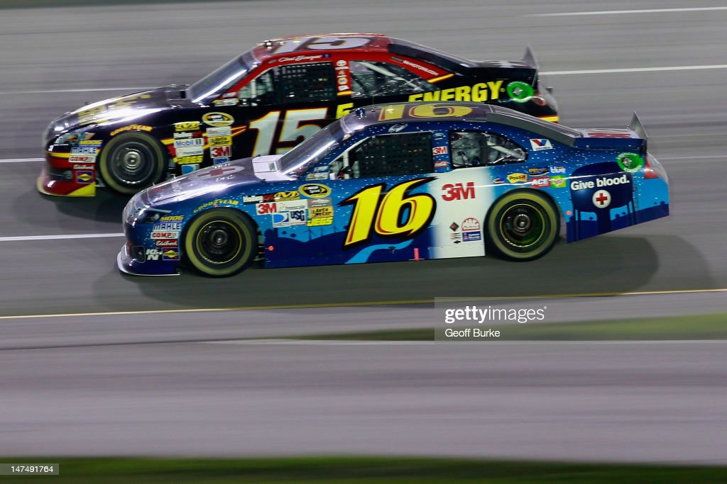 Greg Biffle, driver of the #16 American Red Cross Ford, races Clint Bowyer, driver of the #15 5-hour Energy Toyota, during the NASCAR Sprint Cup Series Quaker State 400 at Kentucky Speedway on June 30, 2012 in Sparta, Kentucky.