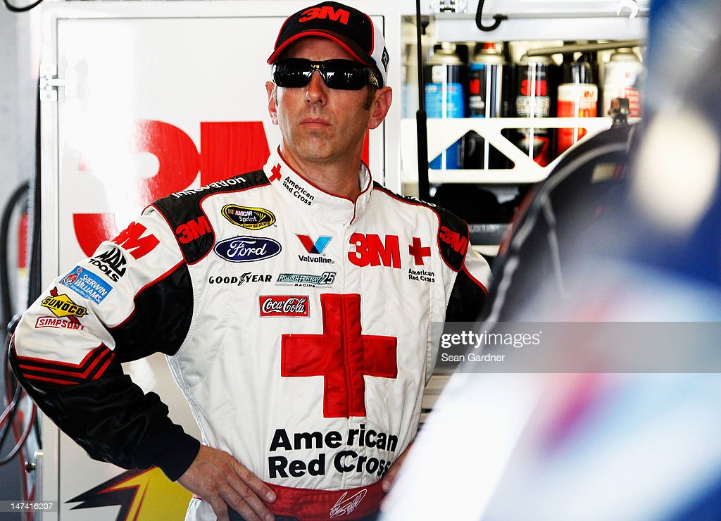 Greg Biffle, driver of the #16 American Red Cross Ford, stands in the garage during practice for the NASCAR Sprint Cup Series Quaker State 400 at Kentucky Speedway on June 29, 2012 in Sparta, Kentucky.