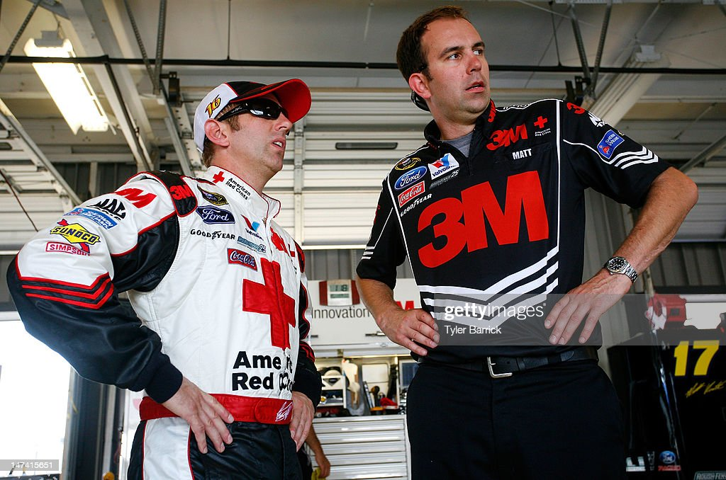 Greg Biffle, driver of the #16 American Red Cross Ford, talks to his crew chief Matt Puccia during practice for the NASCAR Sprint Cup Series Quaker State 400 at Kentucky Speedway on June 29, 2012 in Sparta, Kentucky.