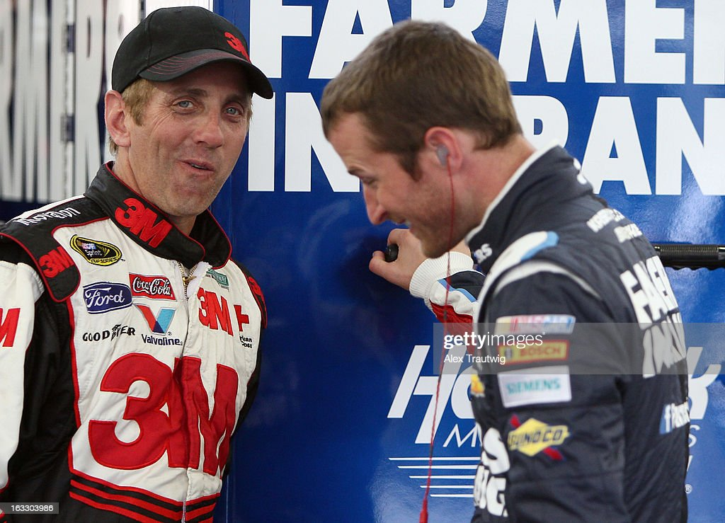 <a gi-track='captionPersonalityLinkClicked' href=/galleries/search?phrase=Greg+Biffle&family=editorial&specificpeople=209093 ng-click='$event.stopPropagation()'>Greg Biffle</a>, driver of the #16 American Red Cross/3M Ford speaks with <a gi-track='captionPersonalityLinkClicked' href=/galleries/search?phrase=Kasey+Kahne&family=editorial&specificpeople=183374 ng-click='$event.stopPropagation()'>Kasey Kahne</a>, driver of the #5 Farmers Insurance Chevrolet, in the garage area during NASCAR Sprint Cup Series testing at Las Vegas Motor Speedway on March 7, 2013 in Las Vegas, Nevada.