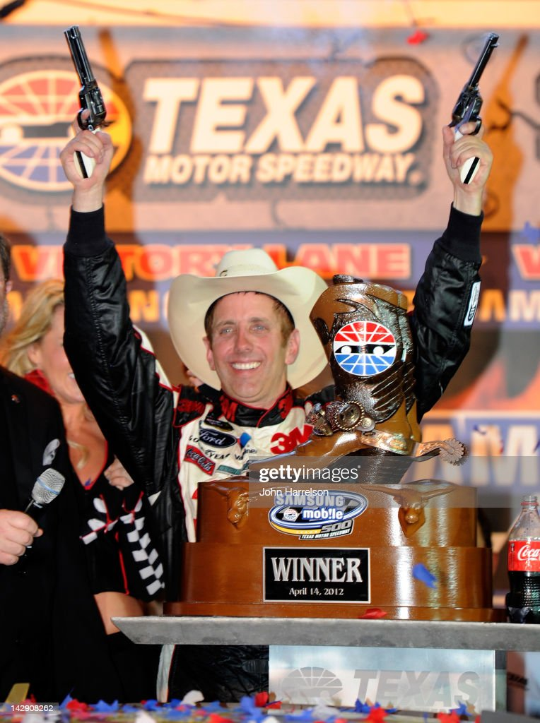 <a gi-track='captionPersonalityLinkClicked' href=/galleries/search?phrase=Greg+Biffle&family=editorial&specificpeople=209093 ng-click='$event.stopPropagation()'>Greg Biffle</a>, driver of the #16 Filtrete Ford, celebrates with the trophy in victory lane after winning the NASCAR Sprint Cup Series Samsung Mobile 500 at Texas Motor Speedway on April 14, 2012 in Fort Worth, Texas.
