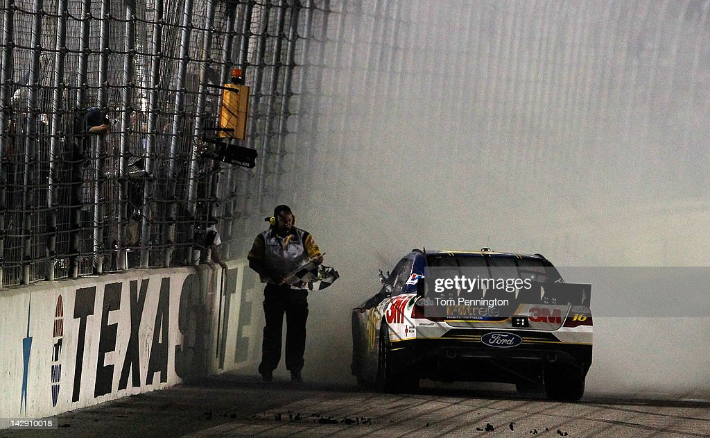 <a gi-track='captionPersonalityLinkClicked' href=/galleries/search?phrase=Greg+Biffle&family=editorial&specificpeople=209093 ng-click='$event.stopPropagation()'>Greg Biffle</a>, driver of the #16 Filtrete Ford, gets the checkered flag after winning the NASCAR Sprint Cup Series Samsung Mobile 500 at Texas Motor Speedway on April 14, 2012 in Fort Worth, Texas.