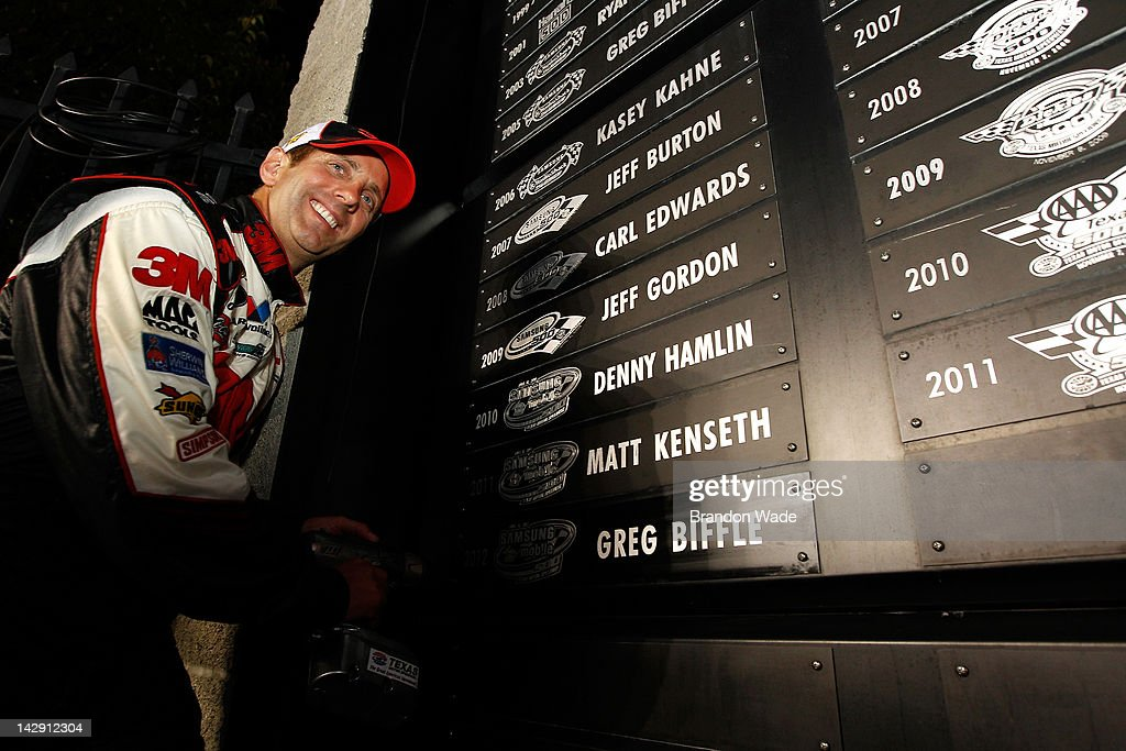 <a gi-track='captionPersonalityLinkClicked' href=/galleries/search?phrase=Greg+Biffle&family=editorial&specificpeople=209093 ng-click='$event.stopPropagation()'>Greg Biffle</a>, driver of the #16 Filtrete Ford, screws his name plate in to the Wall of Champions in Victory Lane after winning the NASCAR Sprint Cup Series Samsung Mobile 500 at Texas Motor Speedway on April 14, 2012 in Fort Worth, Texas.
