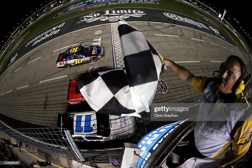 <a gi-track='captionPersonalityLinkClicked' href=/galleries/search?phrase=Greg+Biffle&family=editorial&specificpeople=209093 ng-click='$event.stopPropagation()'>Greg Biffle</a>, driver of the #16 Filtrete Ford, takes the checkered flag to win the NASCAR Sprint Cup Series Samsung Mobile 500 at Texas Motor Speedway on April 14, 2012 in Fort Worth, Texas.