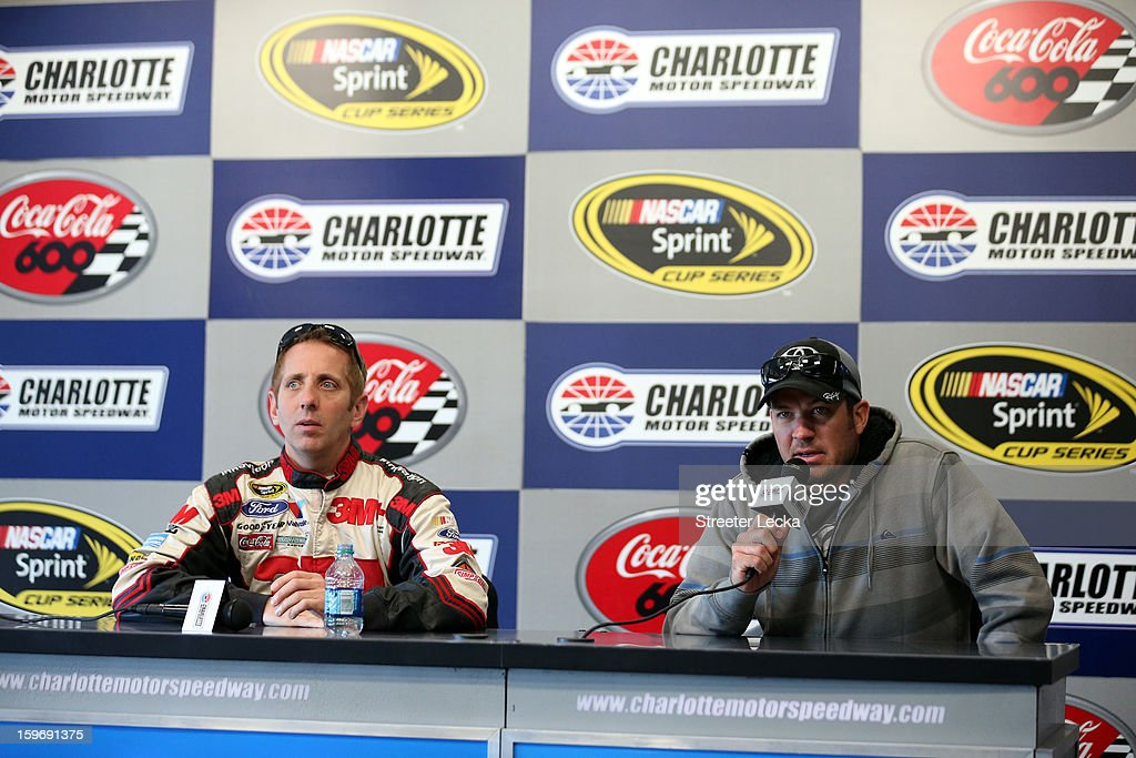 Greg Biffle, driver of the #16 Ford, speaks to the media with Martin Truex Jr., driver of the #56 Toyota, during NASCAR Testing at Charlotte Motor Speedway on January 18, 2013 in Charlotte, North Carolina.