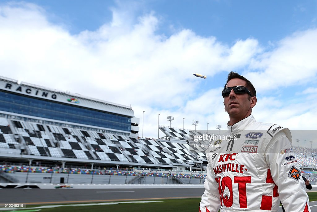 Greg Biffle, driver of the #16 KFC Nashville Hot Ford, walks on the grid during qualifying for the NASCAR Sprint Cup Series Daytona 500 at Daytona International Speedway on February 14, 2016 in Daytona Beach, Florida.
