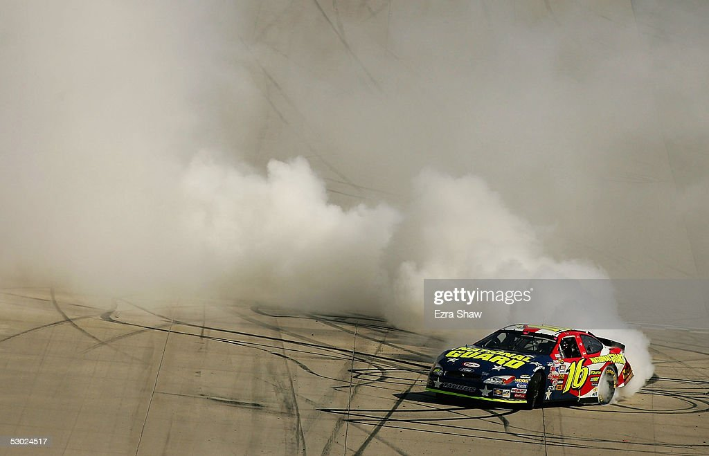 Greg Biffle, driver of the #16 National Guard/Charter Ford car, spins out after winning the MBNA RacePoints 400 NASCAR Nextel Cup Series June 5, 2005 at the Dover International Speedway in Dover, Delaware.