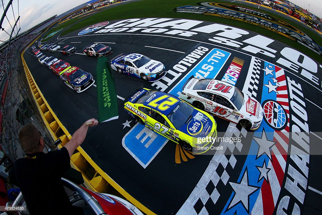Greg Biffle driver of the Ortho Ford and Paul Menard driver of the Serta/Menards Chevrolet lead the field through the green flag to start the NASCAR...