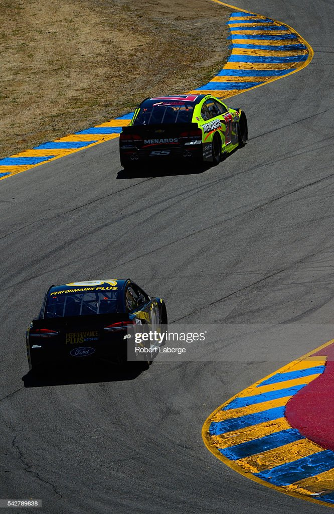 <a gi-track='captionPersonalityLinkClicked' href=/galleries/search?phrase=Greg+Biffle&family=editorial&specificpeople=209093 ng-click='$event.stopPropagation()'>Greg Biffle</a>, driver of the #16 Performance Plus Motor Oil Ford, and <a gi-track='captionPersonalityLinkClicked' href=/galleries/search?phrase=Paul+Menard&family=editorial&specificpeople=540271 ng-click='$event.stopPropagation()'>Paul Menard</a>, driver of the #27 Richmond/Menards Chevrolet, drive during practice for the NASCAR Sprint Cup Series Toyota/Save Mart 350 at Sonoma Raceway on June 24, 2016 in Sonoma, California.