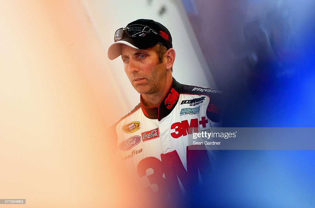 <a gi-track='captionPersonalityLinkClicked' href=/galleries/search?phrase=Greg+Biffle&family=editorial&specificpeople=209093 ng-click='$event.stopPropagation()'>Greg Biffle</a>, driver of the #16 Red Cross Ford, stands in the garage area during practice for the NASCAR Sprint Cup Series Kobalt 400 at Las Vegas Motor Speedway on March 8, 2014 in Las Vegas, Nevada.
