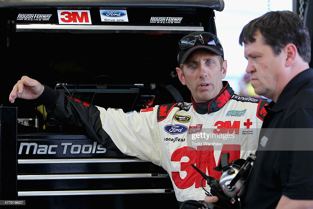 <a gi-track='captionPersonalityLinkClicked' href=/galleries/search?phrase=Greg+Biffle&family=editorial&specificpeople=209093 ng-click='$event.stopPropagation()'>Greg Biffle</a>, driver of the #16 Red Cross Ford, talks with a crew member in the garage during a testing session at Las Vegas Motor Speedway on March 6, 2014 in Las Vegas, Nevada.