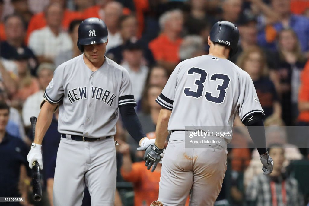 Greg Bird #33 celebrates his solo homerun with Jacoby Ellsbury #22 of the New York Yankees in the ninth inning against the Houston Astros during game one of the American League Championship Series at Minute Maid Park on October 13, 2017 in Houston, Texas.