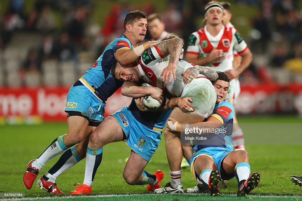 Greg Bird, Chris McQueen and Ashley Taylor of the Titans tackle Joel Thompson of the Dragons during the round 19 NRL match between the St George Illawarra Dragons and the Gold Coast Titans at WIN Jubilee Stadium on July 15, 2016 in Sydney, Australia.