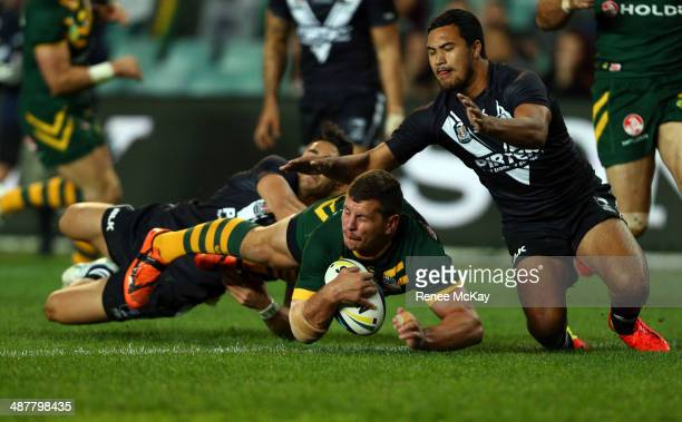 Greg Bird of Australia scores a try in the tackle of Shaun Johnson and Peta Hiku during the ANZAC Test match between the Australian Kangaroos and the...