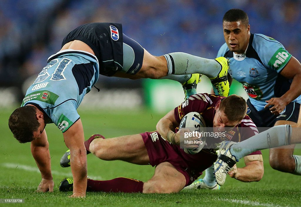 Greg Bird of the Blues tackles Brent Tate of the Maroons during game three of the ARL State of Origin series between the New South Wales Blues and the Queensland Maroons at ANZ Stadium on July 17, 2013 in Sydney, Australia.