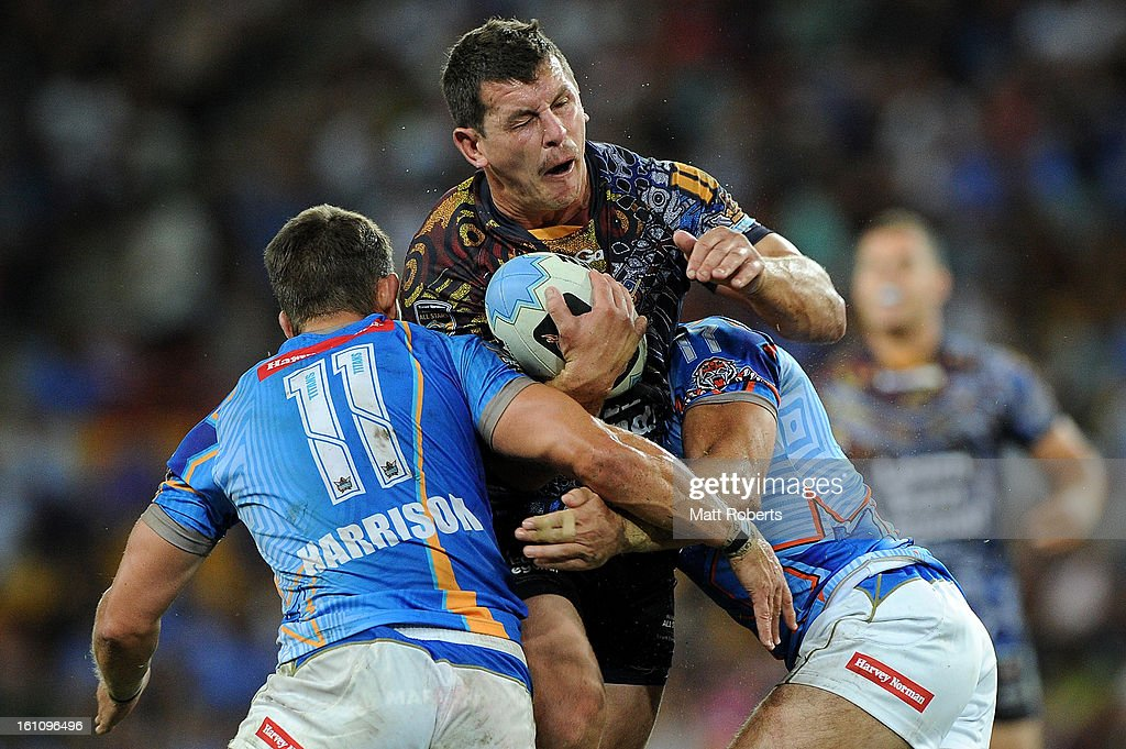 Greg Bird of the Indigenous All Stars is tackled during the NRL All Stars Game between the Indigenous All Stars and the NRL All Stars at Suncorp Stadium on February 9, 2013 in Brisbane, Australia.
