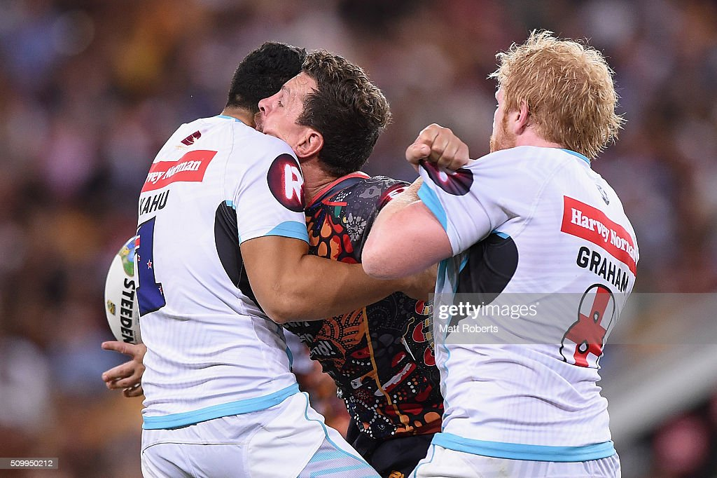 <a gi-track='captionPersonalityLinkClicked' href=/galleries/search?phrase=Greg+Bird+-+Rugby+Player&family=editorial&specificpeople=14983686 ng-click='$event.stopPropagation()'>Greg Bird</a> of the Indigenous All Stars offloads the ball in the tackle during the NRL match between the Indigenous All-Stars and the World All-Stars at Suncorp Stadium on February 13, 2016 in Brisbane, Australia.