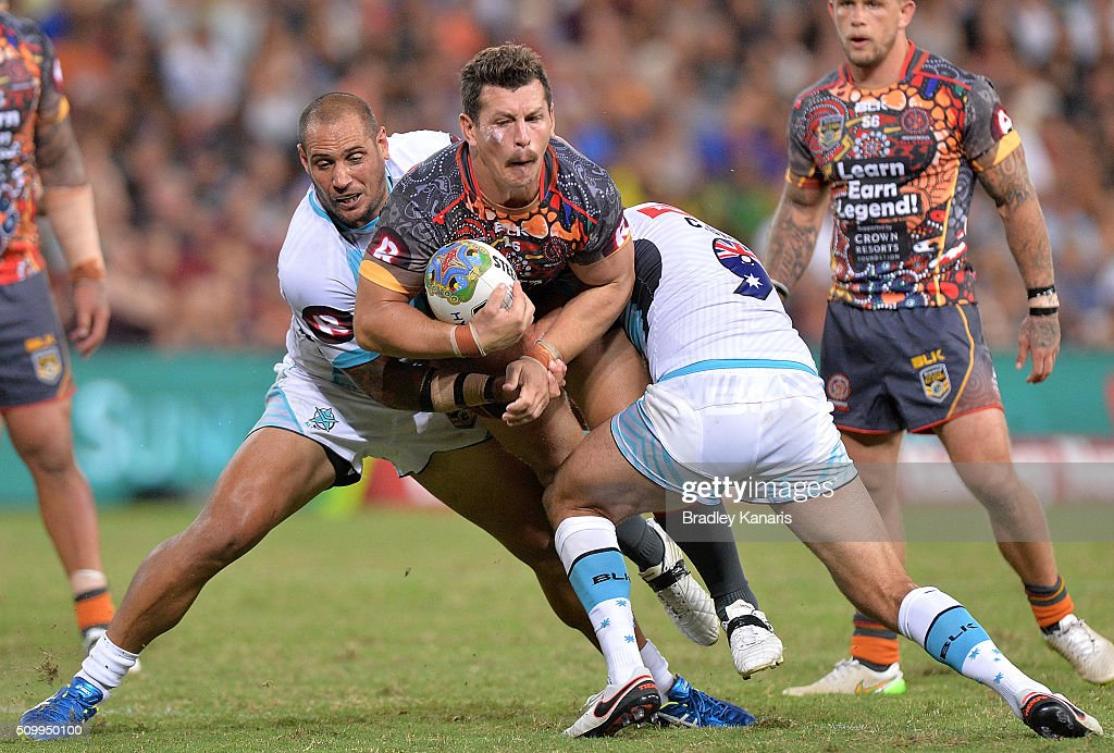 <a gi-track='captionPersonalityLinkClicked' href=/galleries/search?phrase=Greg+Bird+-+Rugby+Player&family=editorial&specificpeople=14983686 ng-click='$event.stopPropagation()'>Greg Bird</a> of the Indigenous All Stars takes on the defence during the NRL match between the Indigenous All-Stars and the World All-Stars at Suncorp Stadium on February 13, 2016 in Brisbane, Australia.