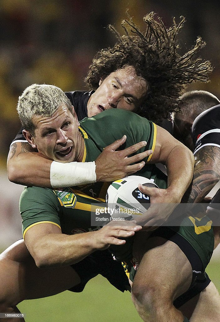 Greg Bird of the Kangaroos is tackled by Kevin Proctor of the Kiwis during the ANZAC Test match between the Australian Kangaroos and the New Zealand Kiwis at Canberra Stadium on April 19, 2013 in Canberra, Australia.