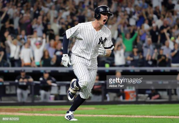 Greg Bird of the New York Yankees celebrates after hitting a solohomerun during the seventh inning against the Cleveland Indians in game three of the...
