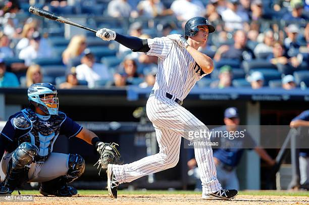Greg Bird of the New York Yankees follows through on a sixth inning double against the Tampa Bay Rays at Yankee Stadium on September 6 2015 in the...