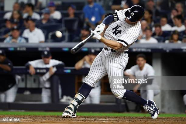 Greg Bird of the New York Yankees hits a solohomerun during the seventh inning against the Cleveland Indians in game three of the American League...