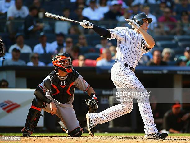 Greg Bird of the New York Yankees hits a three run home run against the Baltimore Orioles in the seventh inning at Yankee Stadium on September 7 2015...