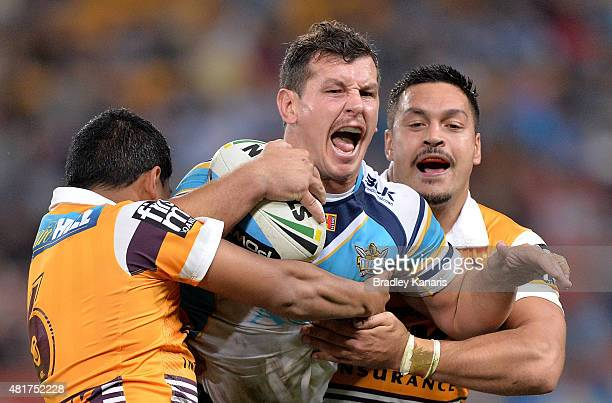 Greg Bird of the Titans attempts to break free from the defence during the round 20 NRL match between the Brisbane Broncos and the Gold Coast Titans...