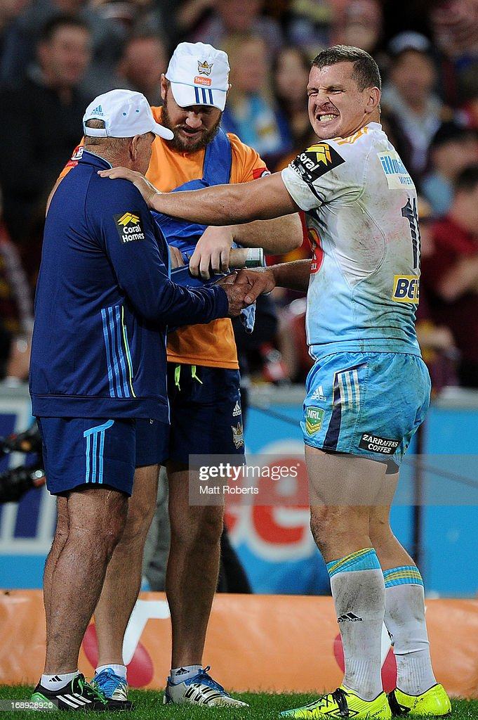 <a gi-track='captionPersonalityLinkClicked' href=/galleries/search?phrase=Greg+Bird+-+Rugby+Player&family=editorial&specificpeople=14983686 ng-click='$event.stopPropagation()'>Greg Bird</a> of the Titans grimaces during the round 10 NRL match between the Brisbane Broncos and the Gold Coast Titans at Suncorp Stadium on May 17, 2013 in Brisbane, Australia.