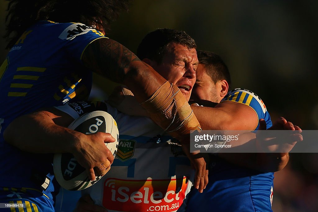 <a gi-track='captionPersonalityLinkClicked' href=/galleries/search?phrase=Greg+Bird+-+Rugby+Player&family=editorial&specificpeople=14983686 ng-click='$event.stopPropagation()'>Greg Bird</a> of the Titans is tackled during the round 11 NRL match between the Parramatta Eels and the Gold Coast Titans at Glen Willow Regional Sports Stadium on May 26, 2013 in Mudgee, Australia.