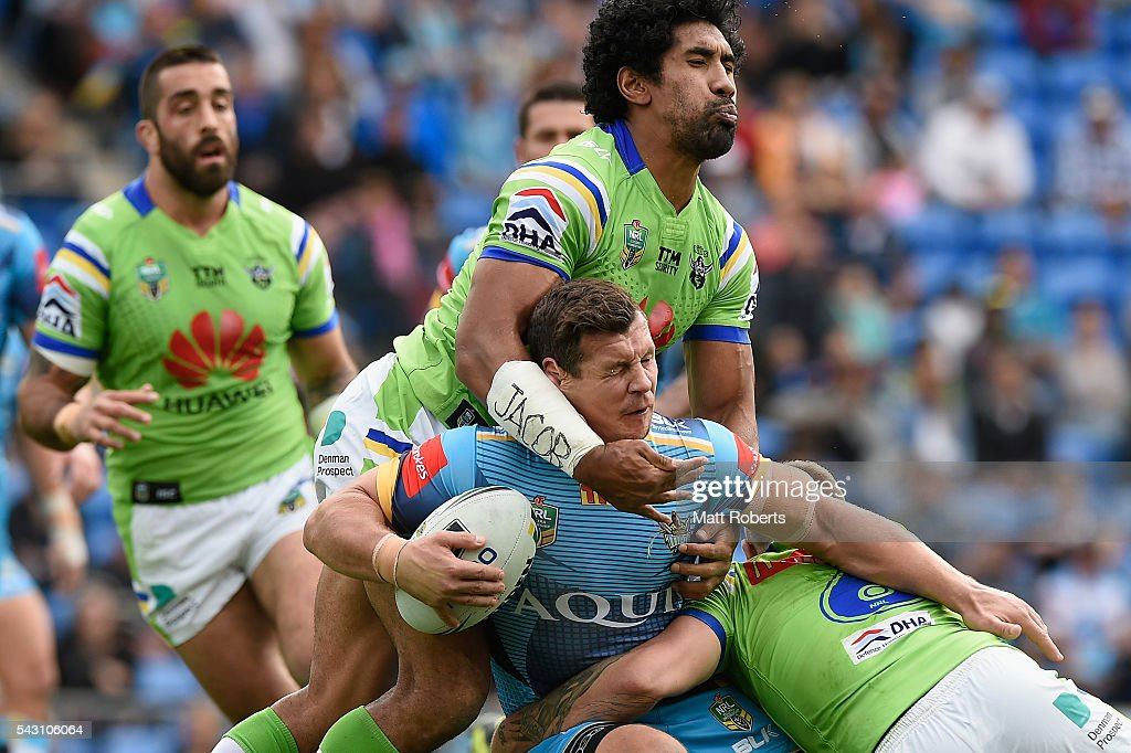 Greg Bird of the Titans is tackled during the round 16 NRL match between the Gold Coast Titans and the Canberra Raiders at Cbus Super Stadium on June 26, 2016 in Gold Coast, Australia.